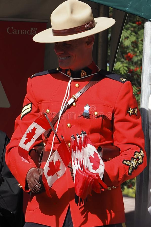 RCMP Officer With Canada Flags. At Canadian citizenship ceremony Edmonton Alberta September 17, 2017 stock photos