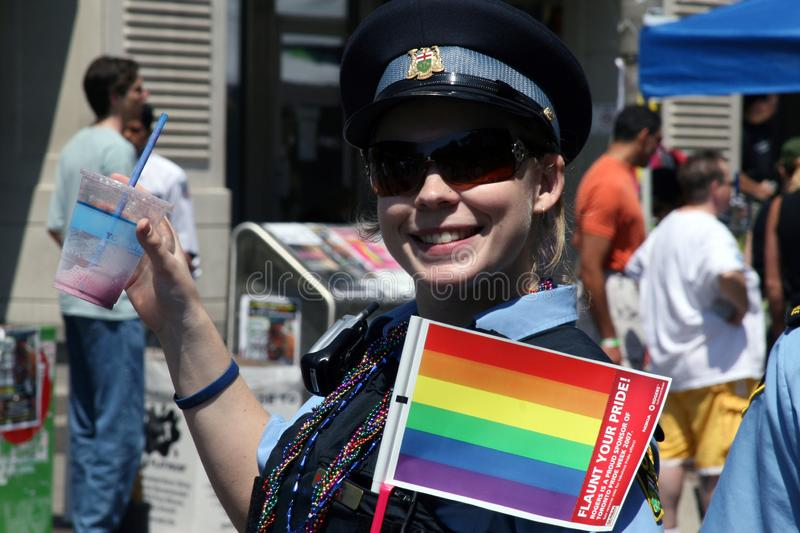 RCMP policewoman waves rainbow flag on Pride parade in Toronto, Canada in 2007 royalty free stock photos