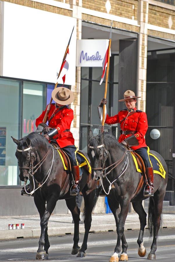 RCMP riding in Saint Patrick's Day parade, Ottawa, Canada royalty free stock photo