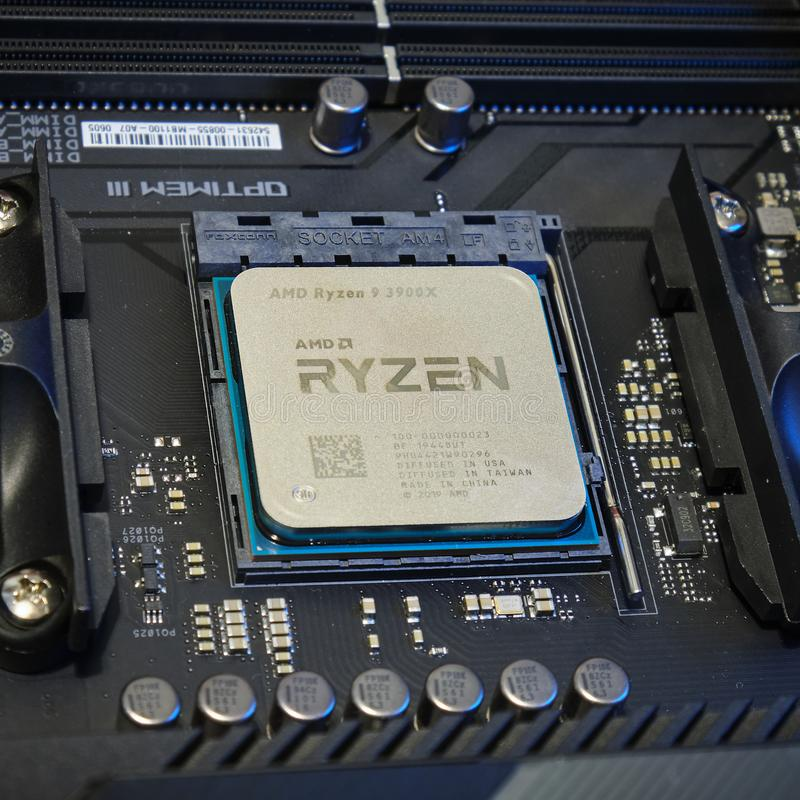 3rd Gen AMD Ryzen 9 3900X CPU mounted on a motherboard AM4 socket - close up royalty free stock photo