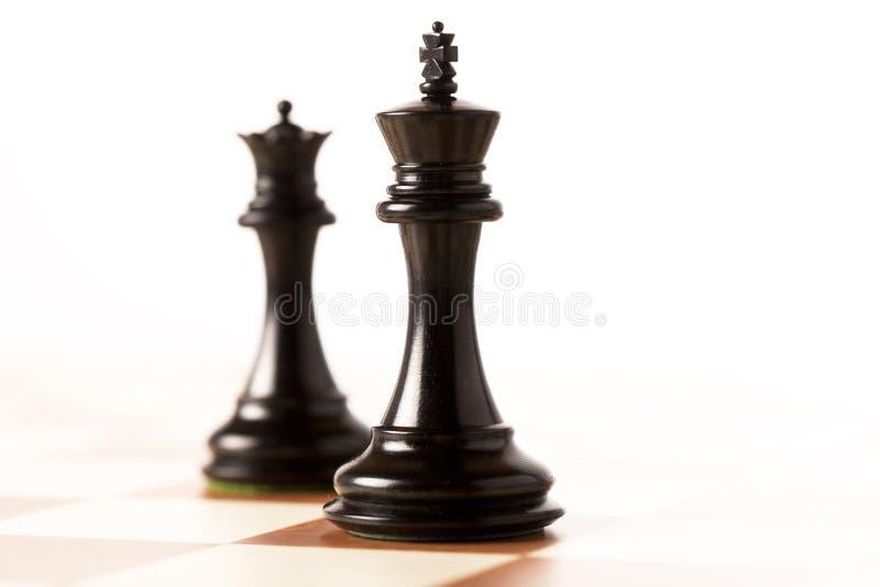 Re e regina neri di scacchi immagini stock