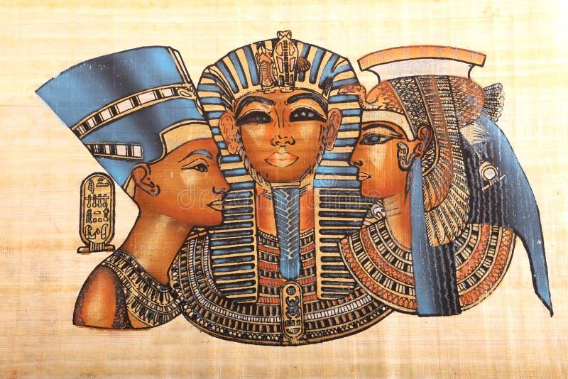 Re egiziani anziani ed arte della regina sul papiro immagini stock