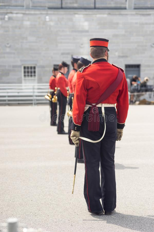 Re-enactment soldiers standing at attention in a parade square stock image