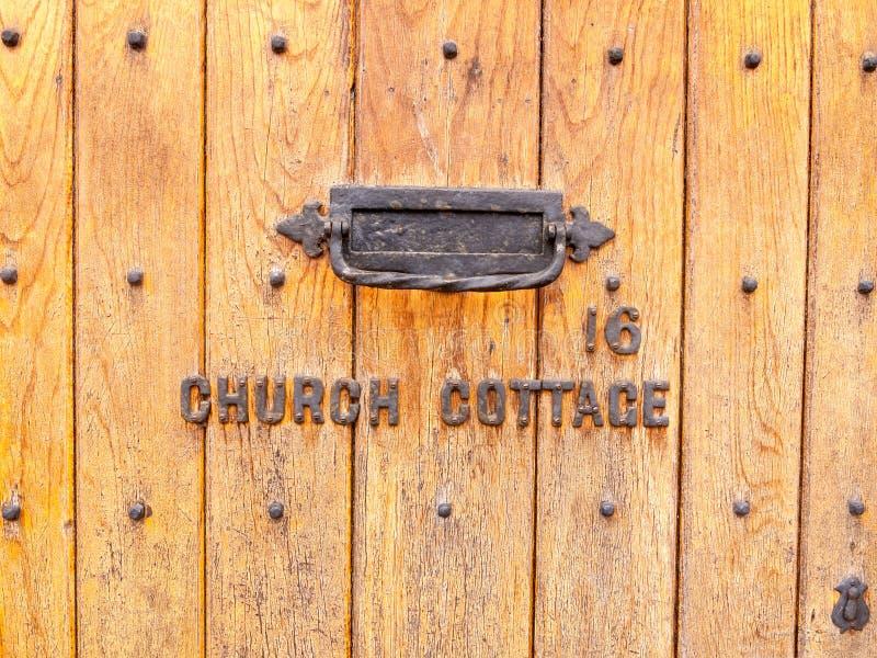 re inglés viejo de la caja de letra del vintage de la cabaña de la iglesia de la casa de la puerta principal foto de archivo