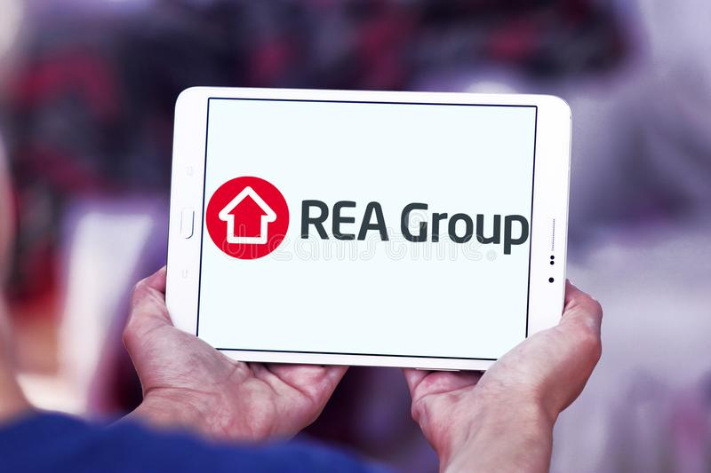 REA Group logo. Logo of REA Group on samsung tablet . REA Group is a global online real estate advertising company listed on the Australian Stock Exchange royalty free stock photography