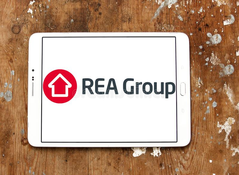 REA Group logo. Logo of REA Group on samsung tablet on wooden background. REA Group is a global online real estate advertising company listed on the Australian royalty free stock photography