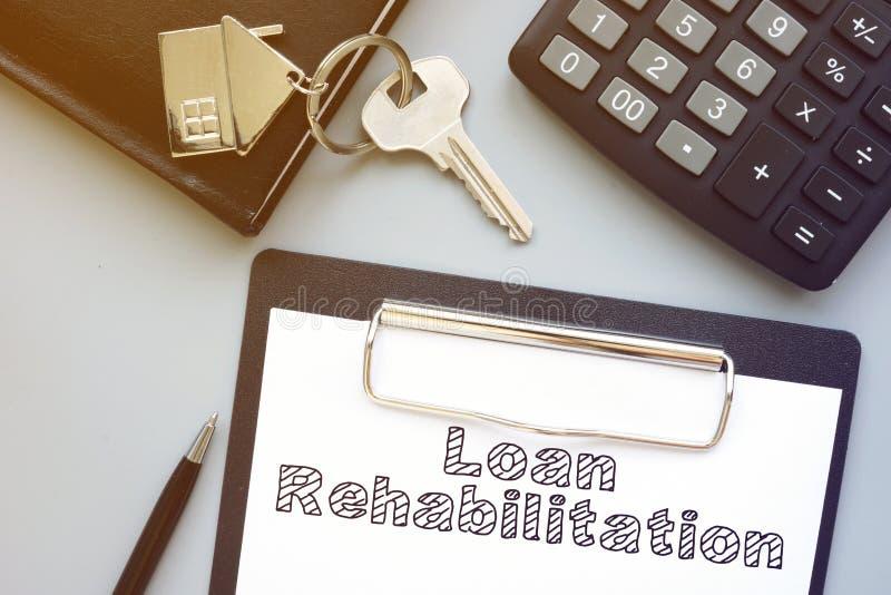 A reabilitação de empréstimos é mostrada na foto de negócios conceitual imagem de stock