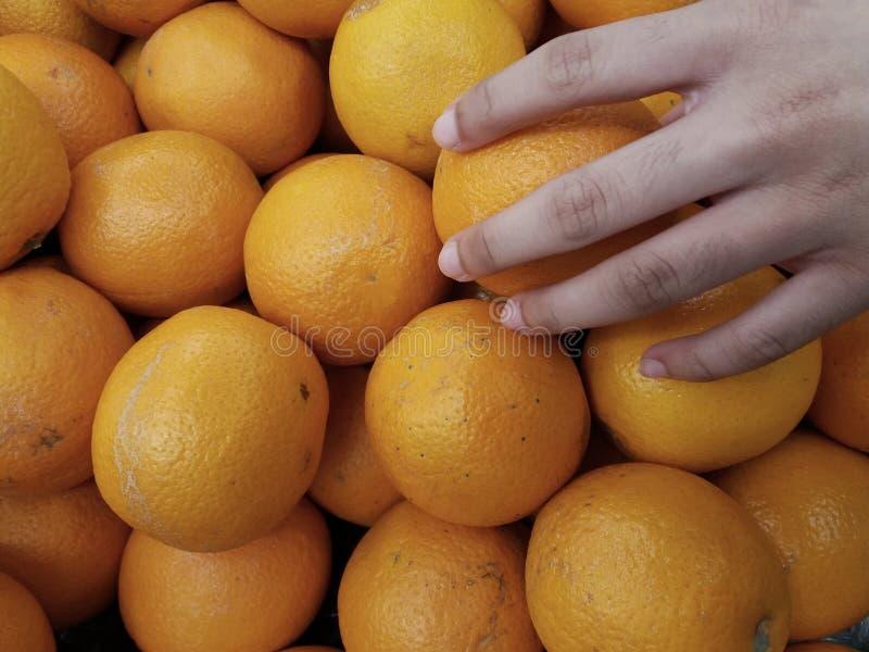 Reach hand. Closeup images of hand reach a orange stock image