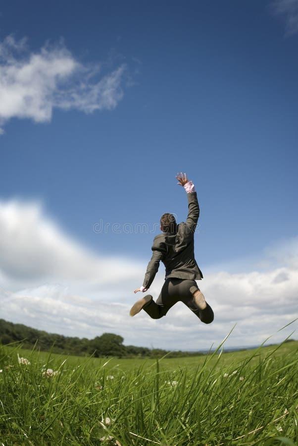 Reach for the Sky. A businessman reaching for the sky