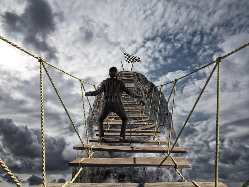Reach the success with difficult. Achievement business goal and Difficult career concept. With dangerous bridge stock images
