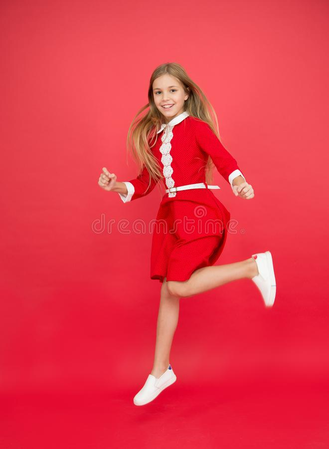 Reach the unattainable. Small girl child jumping. Happy life. Full of energy. Active games. happy holidays. sense of. Freedom. celebrating success. Feel freedom royalty free stock photos