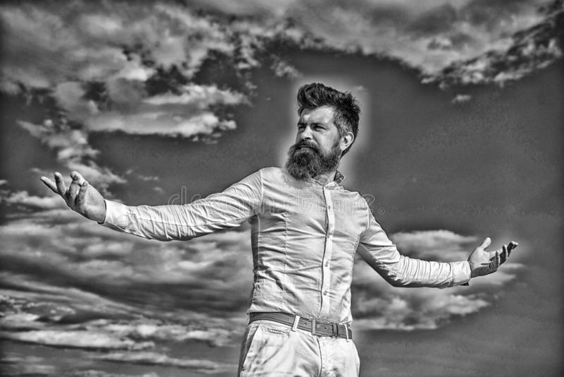 Reached top. Power and freedom. Hipster with beard and mustache looks attractive fashionable white shirt. Guy enjoy top. Achievement. Man bearded hipster formal stock image