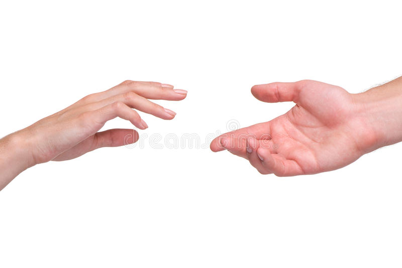 Reaching female and male hands. Isolated on white background. Concept for rescue, friendship, guidance stock images