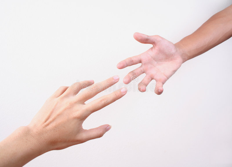 Reaching hands stock images