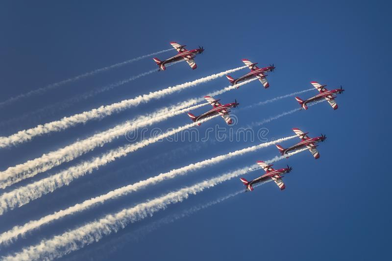 Reactive jet plane flying in formation on blue sky stock images