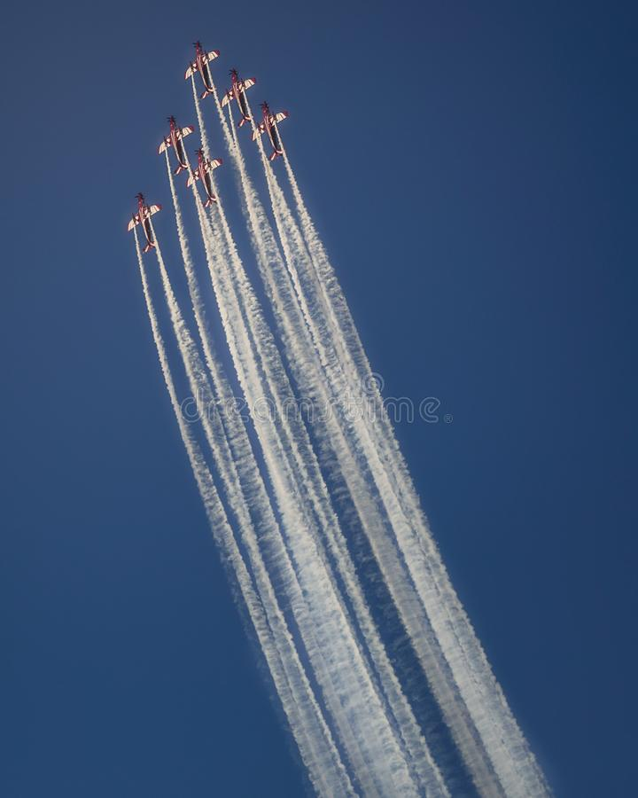 Reactive jet plane flying in formation on blue sky stock photos