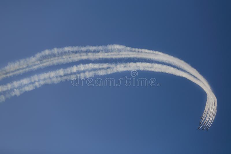 Reactive jet plane flying in formation on blue sky royalty free stock photo