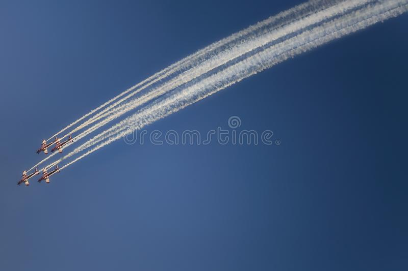 Reactive jet plane flying in formation on blue sky stock photography