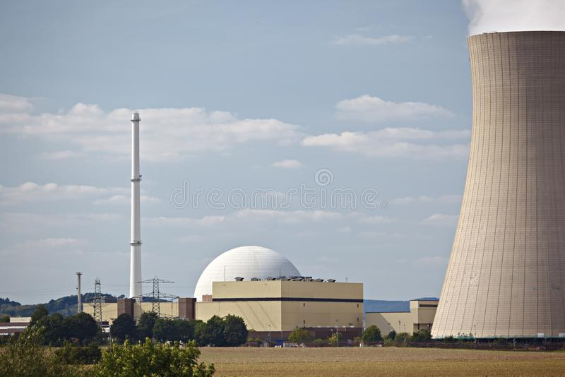 Nuclear Power Plant. Reactor building and smoke stack of a nuclear power station next to the cooling tower stock image