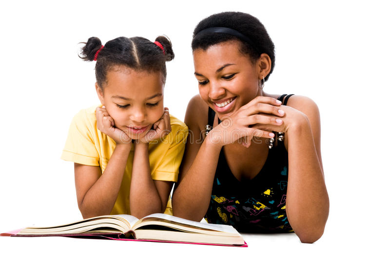 Read the book. Image of woman and girl reading the book together