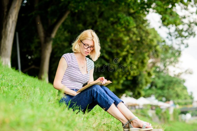 Read fairytale. woman in park reading book. reading is my hobby. Summer study. interesting story. Relax and get new. Information. student girl with book outdoor royalty free stock photography