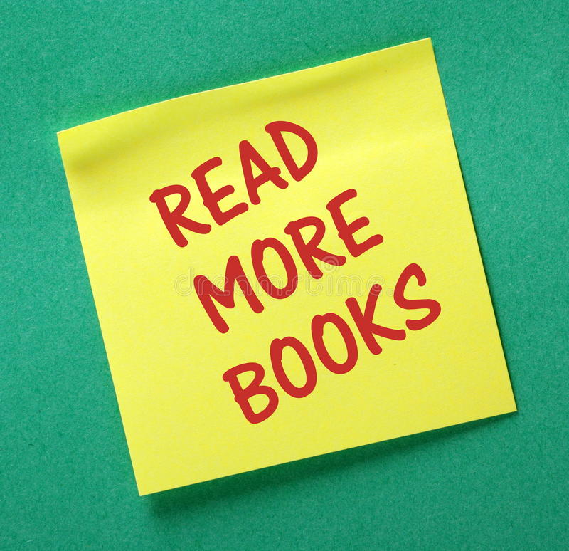Read More Books Reminder. The phrase Read More Books in red text on a yellow sticky note attached to a green notice board as a reminder royalty free stock photos