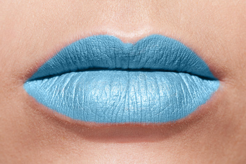 Read my lips. Perfect lips in blue lipstick royalty free stock images