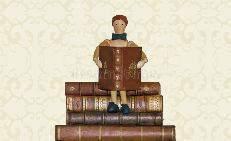 Download Reader, Sitting On Pile Of Books Stock Photo - Image: 26635822