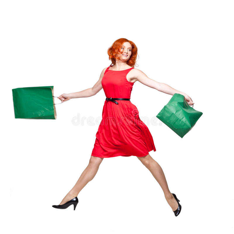 Download Readhead With Green Shopping Bags Jumping Royalty Free Stock Photo - Image: 25558975
