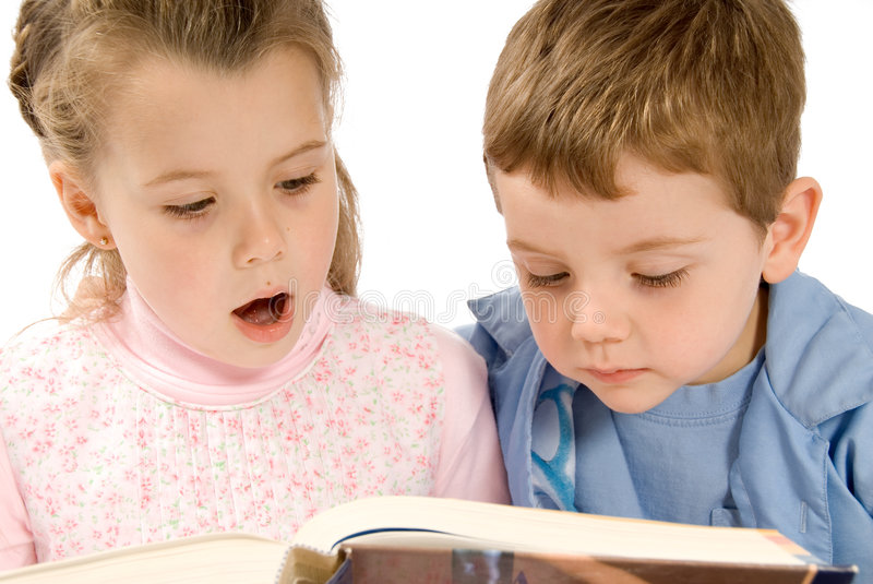 Reading. Brother and sister reading a big book royalty free stock photography