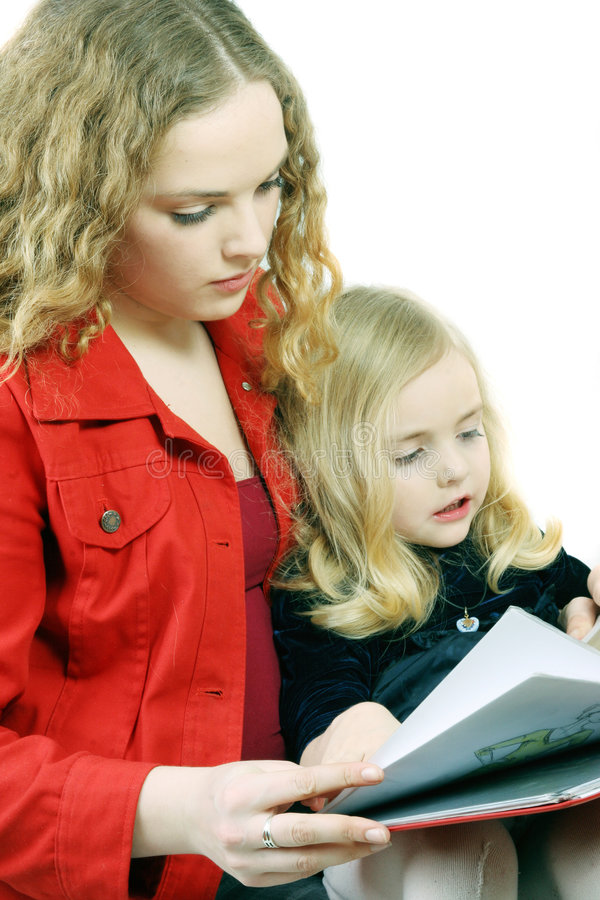 Reading. Kid - activity in preschool - over white royalty free stock photo