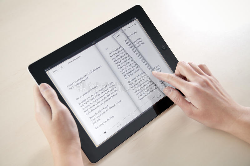 Reading On Apple iPad2 royalty free stock images