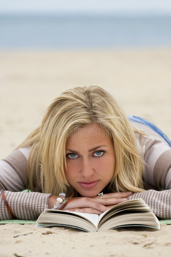 Download Reading At The Beach stock photo. Image of outside, resting - 8171858