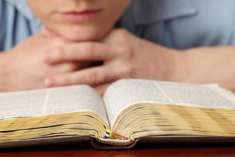 Reading the Bible stock photos
