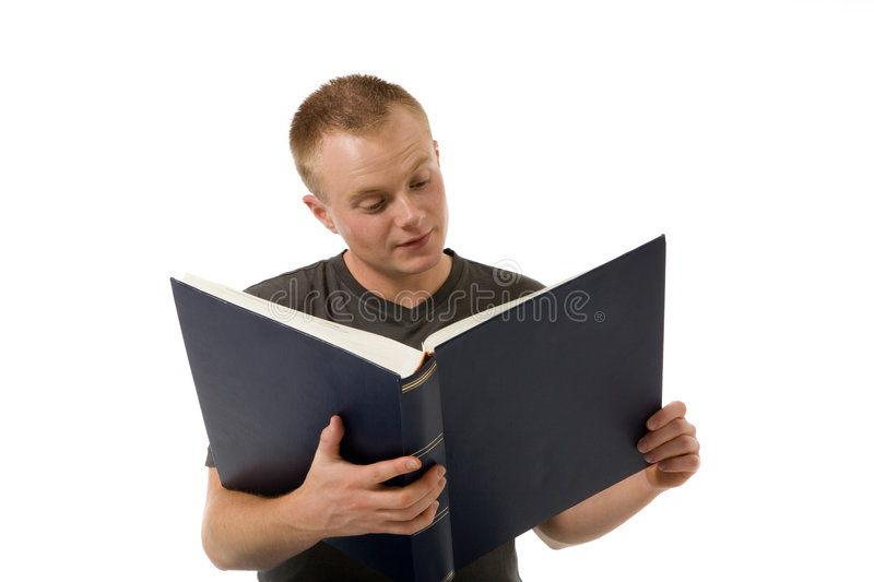 Reading a book. Young man with a big book stock photography