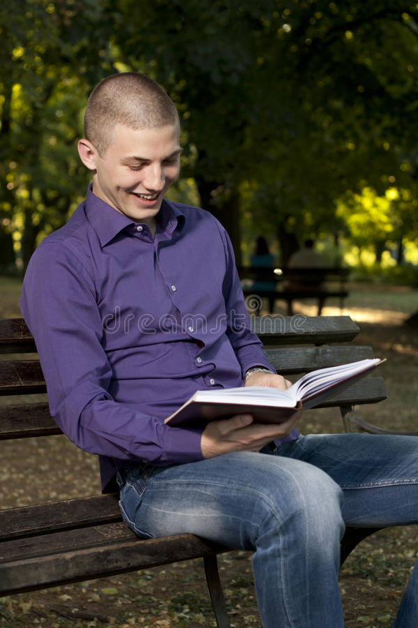 Download Reading a book stock image. Image of green, caucasian - 25473833