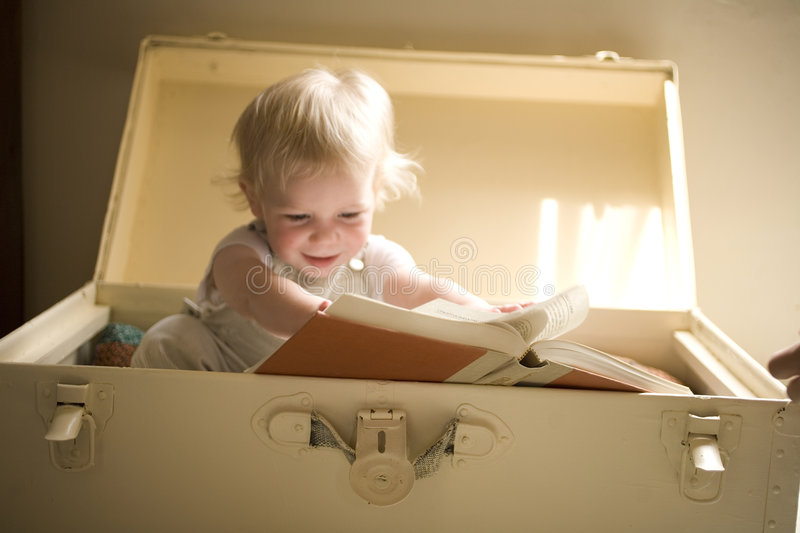 Download Reading a book stock photo. Image of rays, indoors, play - 5200614