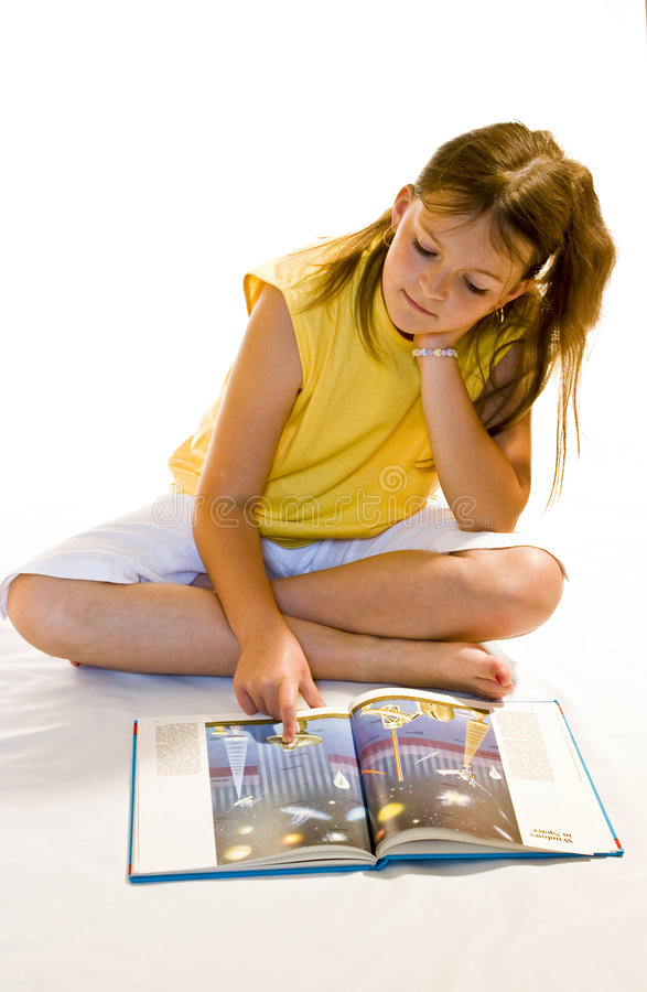 Reading book. Young girl reading a book stock photo