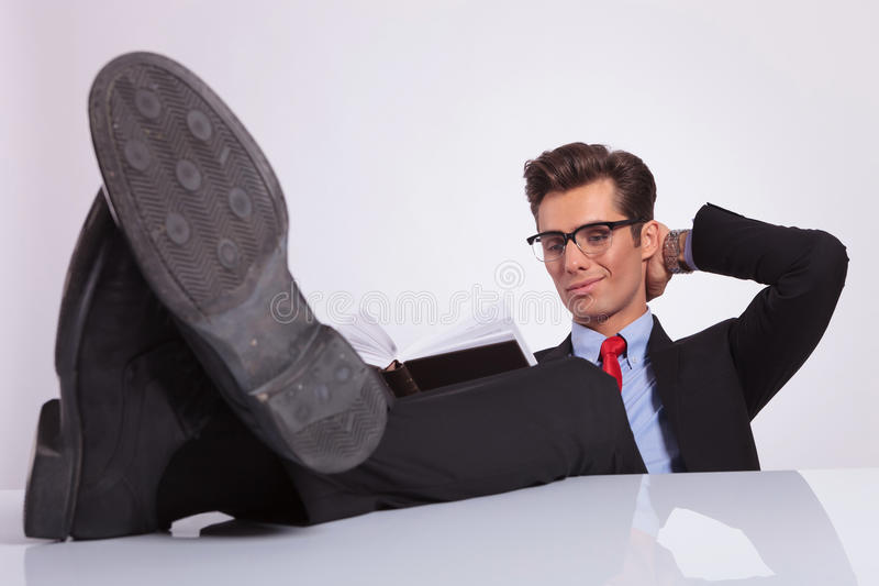 Download Reading Book With Legs On Desk Stock Image - Image: 29636151
