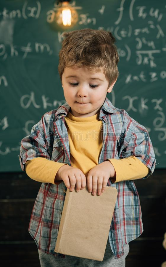 Reading a book. Little boy learn reading in school. English reading lesson. I love reading. Books are full of incredible royalty free stock images