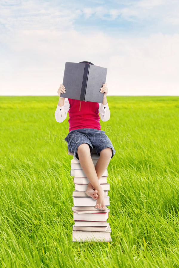 Reading Book Outdoor Royalty Free Stock Image