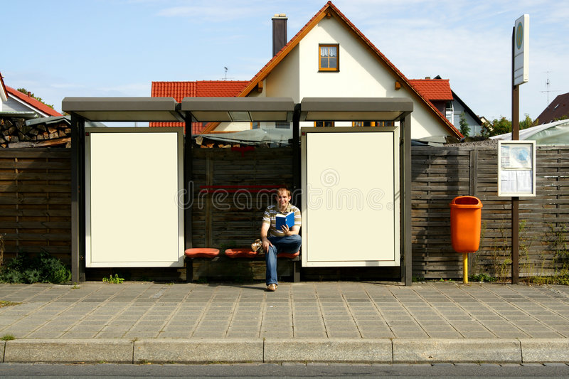 Download Reading at the bus stop stock photo. Image of media, panel - 7773830