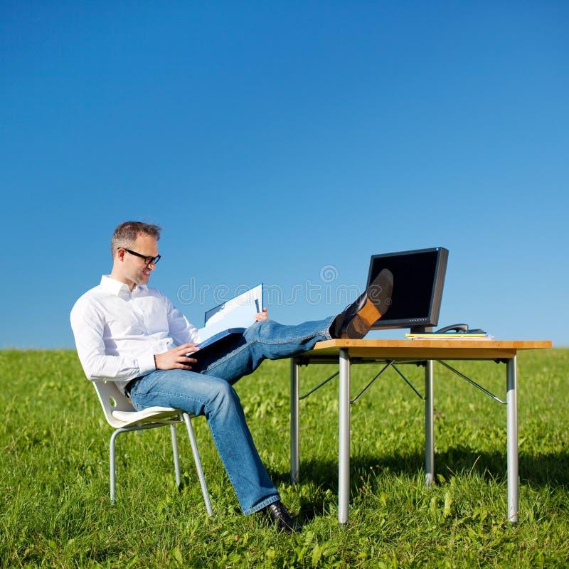 Reading businessman royalty free stock image