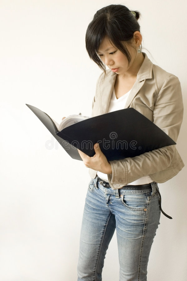 Reading on document stock image