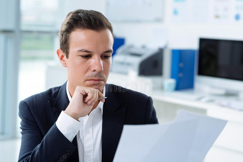 Reading a document royalty free stock image