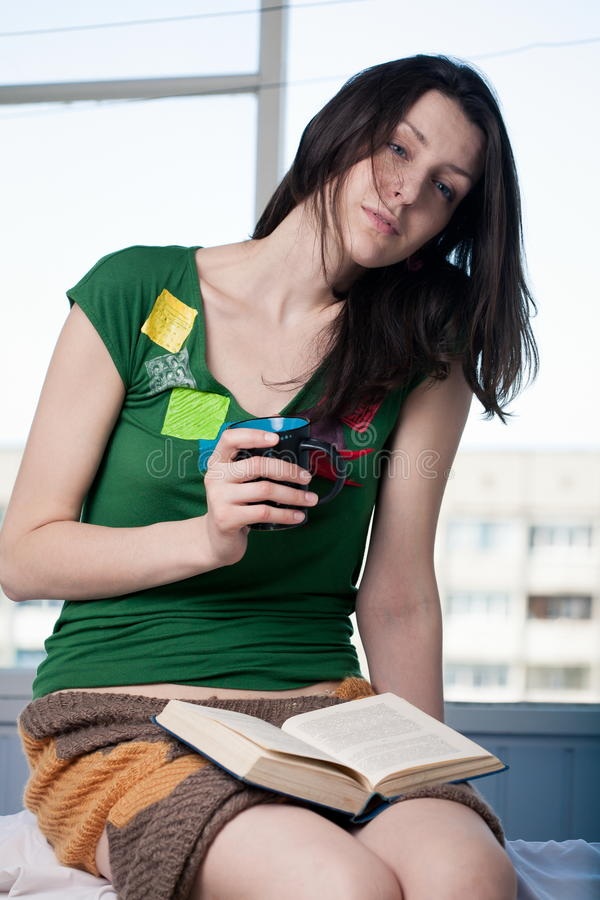 Reading And Drinking Hot Stock Images