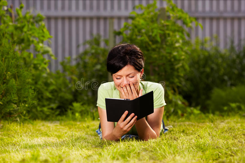 Reading e-book in the park stock photo