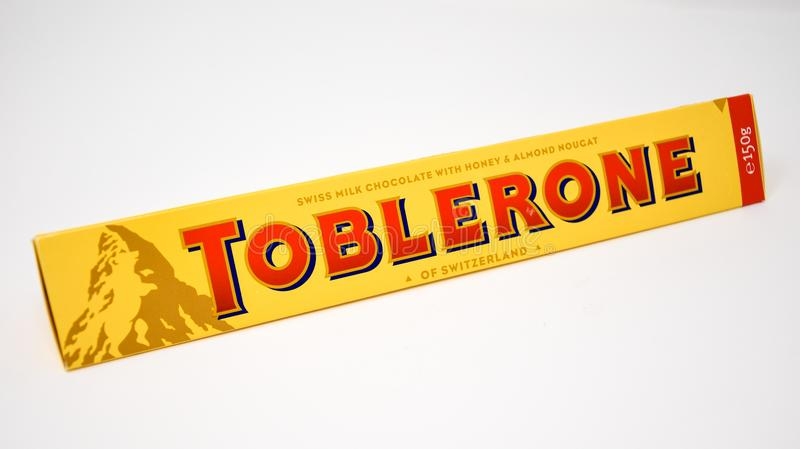 A Toblerone Chocolate bar. Reading, England - December 28 2017: A large bar of Swiss Toblerone Almond filled chocolate royalty free stock photo