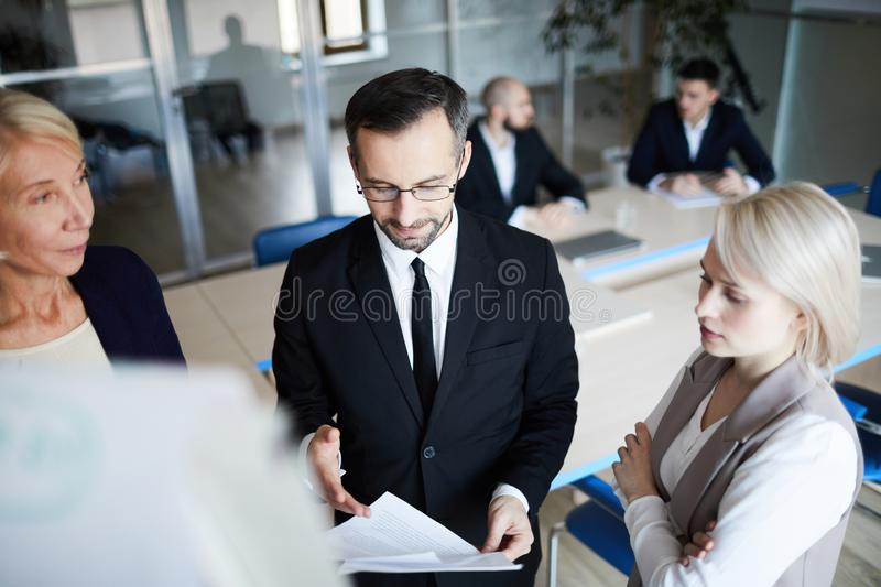 Reading financial document royalty free stock image