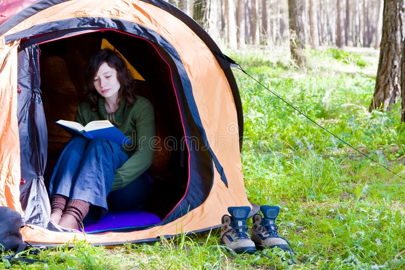 Reading in the forest royalty free stock photo